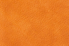 Texture of genuine leather close-up, cowhide, orange. For natural, artisan backgrounds, backdrop, substrate composition Royalty Free Stock Photos