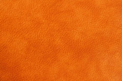 Texture of genuine leather close-up, cowhide, orange. For natural, artisan backgrounds, substrate composition use. Texture of genuine leather close-up, cowhide Stock Photography