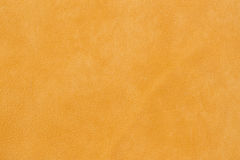 Texture of genuine leather close-up, cowhide. Soft sunny orange color. For natural, artisan backgrounds, substrate Stock Images
