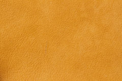 Texture of genuine leather close-up, cowhide. Sunny orange color. For natural, artisan backgrounds, substrate. Texture of genuine leather close-up, cowhide. Soft Royalty Free Stock Photography