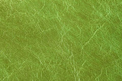 Texture of genuine leather close-up, fashion green color. For background , backdrop, substrate, composition use. With. Texture of genuine eather close-up. For Royalty Free Stock Photos