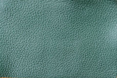 Texture of genuine leather close-up, fashion green color. For background , backdrop, substrate, composition use. With. Texture of genuine leather close-up Stock Photo