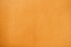 Texture of genuine leather close-up, red-based orange, for background , backdrop, substrate, composition use. Texture of genuine leather close-up, red-based Royalty Free Stock Images