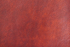 Texture of Genuine Leather shiny, antique, cracked, ,maroon color, background, surface. Texture of Genuine Leather spotted, painted, with wrinkle, crease, brown stock photos
