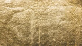 The texture of the gold. Golden material, surface, background. Close-up Royalty Free Stock Photo