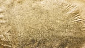 The texture of the gold. Golden material, surface, background. Close-up Stock Photo