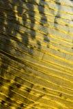 Golden texture of silk. Texture of the golden colour silk Royalty Free Stock Photo