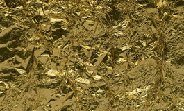 Texture of golden foil. Close up view royalty free stock images
