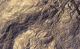 Texture of golden foil close up. View stock image