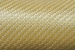 Texture of Golden Kevlar Fiber Stock Images