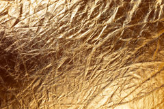Texture of golden metallizic fabric Stock Photos