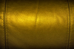 Texture of Golden Sofa Leather. Close up texture of Golden Sofa Leather with seam at the edges Background Stock Image