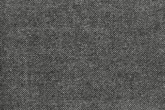 Texture of grained fabric with black specks. The textured pure background grained fabric with specks of black color stock photo