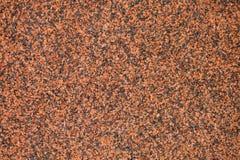 Texture granulaire d'une dalle de granit poli rouge photo stock