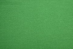 The texture of a grass green cotton cloth. Texture of a cotton cloth for background Stock Photos