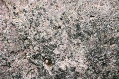 Texture of gray with a black, multi-colored old solid stone with cracks, bumps, pits and patterns. Background Stock Photos