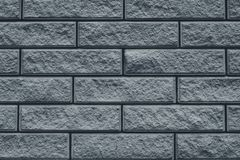 Texture of gray brick wall. The wall is tiled decorative. Grey stone background of house facade. Brick wall texture grunge backgro stock photos