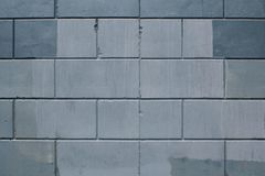 Texture of gray concrete blocks with splashes of red in the seams royalty free stock photo