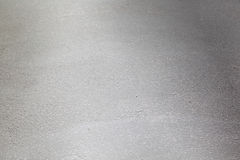 Texture of gray flooring. Fine texture of a gray floor or flooring.  Suitable for an abstract background Royalty Free Stock Photo
