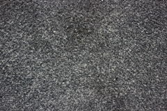 Texture of gray granite. Texture of dark gray roughly processed granite Stock Photos