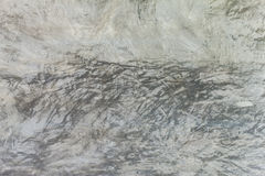 Texture of the gray polished concrete wall with scratches Royalty Free Stock Image