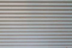 Texture of Gray Rolling Steel Doors stock image
