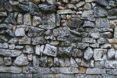 Texture of gray rough granite stone wall Royalty Free Stock Photo
