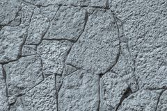 Texture of gray silvery color stone wall with cracks Stock Photo