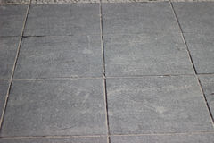 Texture of gray square paving tiles on the entire frame Stock Photos