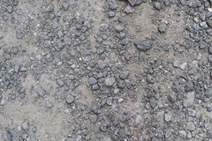 Texture of gray stones and some sand. Many gray stones and some gray sand texture backgroung Big and small stones Royalty Free Stock Photos