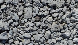 Texture of gray stones in the sun royalty free stock images
