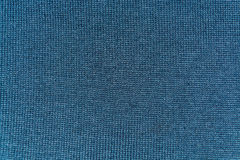 The texture of gray woolen knitted fabric Royalty Free Stock Image
