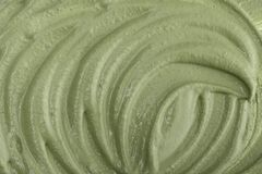 Texture of green clay mask cream. To the face and body closeup.  May use as background Royalty Free Stock Photo