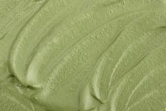 Texture of green clay mask cream. To the face and body closeup.  May use as background Stock Photos