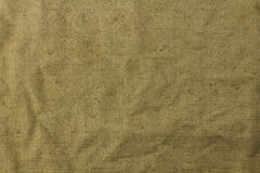 Texture of green coarse cloth Royalty Free Stock Photos