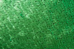 Texture of green color sequins close-up macro royalty free stock images