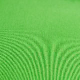 Texture green dense tissue. Woven cotton linen fabric textile textured backdrop in pastel light yellow spring green color tone: Eco friendly material Stock Photo