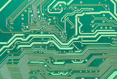 Texture of green electronic plate. Texture of an electronic plate of green color with metallic paths Royalty Free Stock Images