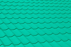The texture of green roof tiles. The texture of the green tile roof of the building Royalty Free Stock Photography
