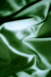 Texture of a green silk Stock Images