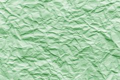 Texture of green wrinkled paper. Closeup royalty free stock photo