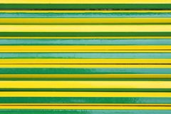 Texture green and yellow pencils alternating. Close up Texture green and yellow pencils alternating stock image