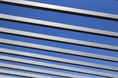 Texture of the grey and black stripes. On the blue background royalty free stock photo