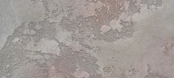 The texture of grey loft-concrete is a decorative coating for walls Stock Photo