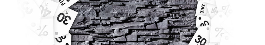 Texture of grey stonewall with discount labels Stock Images