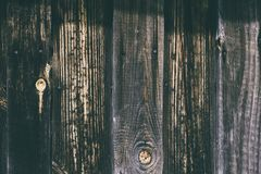Texture of grey wooden fence. Grey wooden planks background stock photo