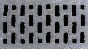 Texture grise de brique avec des trous photographie stock libre de droits