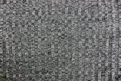 Texture grise de laine d'un morceau de tissu Images stock