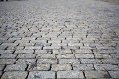 Texture grise de route de pavé rond, place rouge Photographie stock