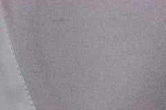 Texture grise de tissu avec la couture Image libre de droits